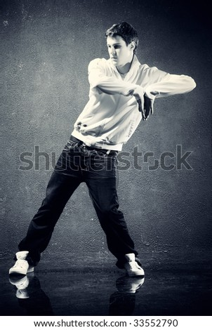 Young man modern dance. Dark blue and yellow tint. - stock photo