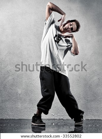 Young man modern dance. High contrast colors. - stock photo