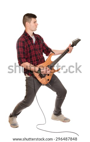 young man musician with guitar on white background - stock photo