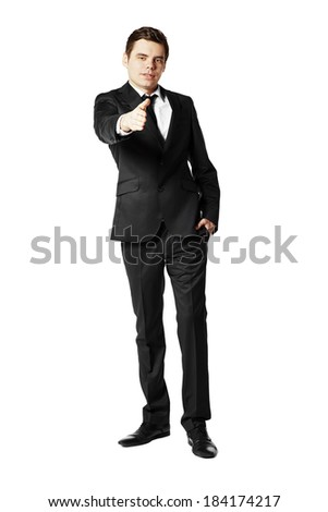 Young man offering for handshake against white background