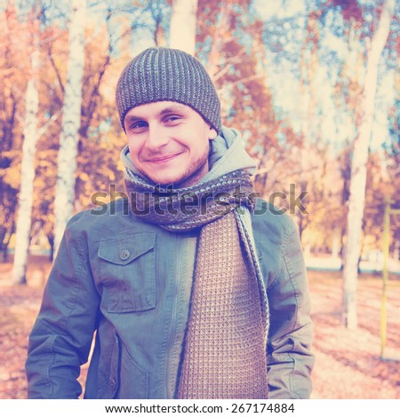 Young man on a street forest. Instagram style filtred image - stock photo