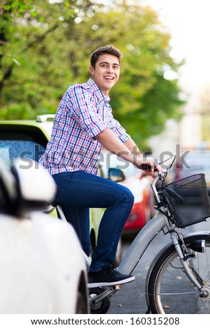 Young man on bike - stock photo