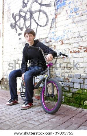 Young man on bike - stock photo