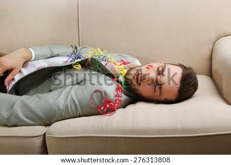 Young man on couch after fun close up - stock photo