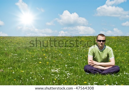 young man on green meadow - stock photo