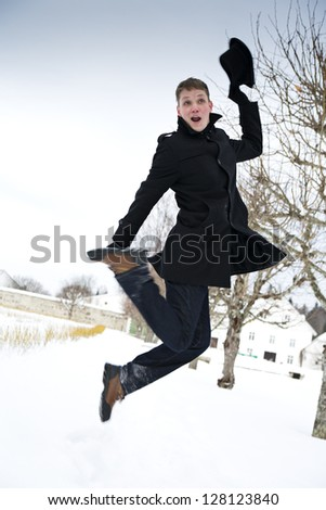 Young man on jump curve legs at air