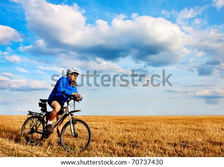 young man on mountain bike on sunny day