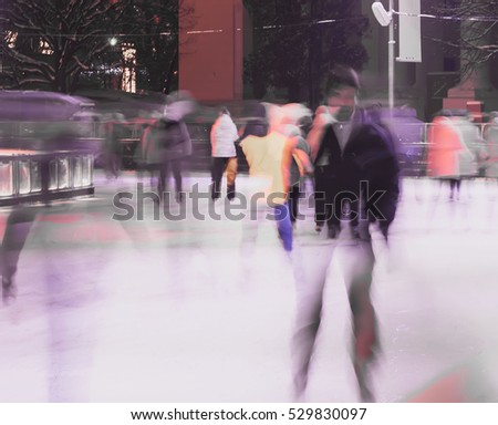 Young man on skates against the backdrop of city skating rink in park. Image blurring and double composition