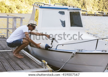 young man on the boat