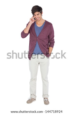 Young man on the phone on a white background - stock photo