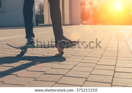 Young man on the skate in city park - stock photo