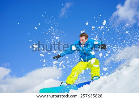 young man on the snowboard in winter