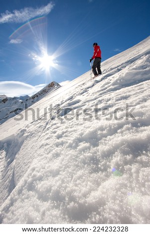 Young man on top of a mountain ready for skiing