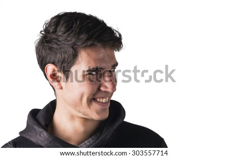 Young man outdoor doing silly face and stupid expression, turning to a side, isolated on white