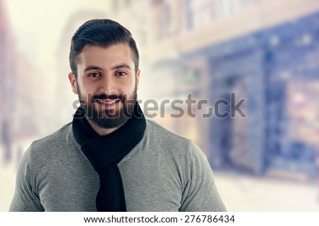 Young man outdoors portrait  - stock photo
