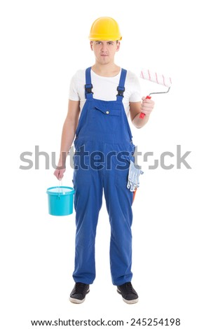 young man painter in blue coveralls isolated on white background - stock photo
