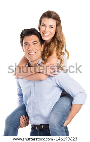 Young Man Piggybacking Woman Isolated On White Background
