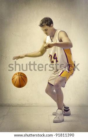 Young man playing basketball - stock photo
