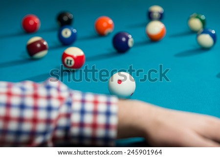 Young Man Playing Billiards Lined Up To Shoot Easy Winning Shot - stock photo