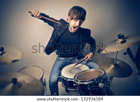young man playing drums - stock photo