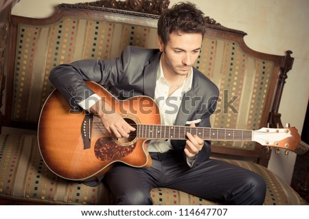 Young Man Playing Guitar,ITALY