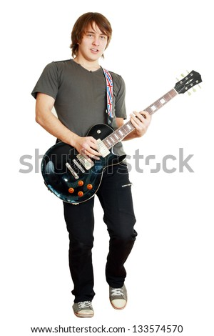 Young man playing guitar on white background looking to the camera - stock photo