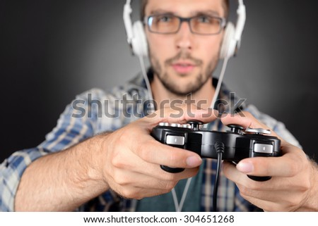 Young man playing video games close up - stock photo