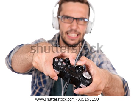 Young man playing video games isolated on white
