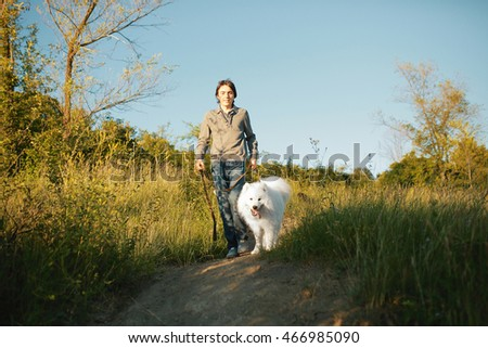 Young man playing with fun dog