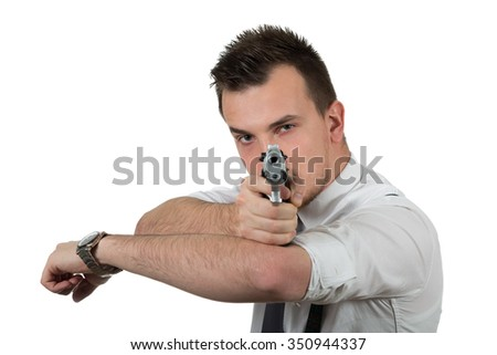 Young man pointing a gun isolated on white background
