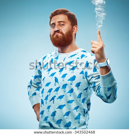 Young man pointing his finger up with smoke. the concept of self-confidence and authoritativeness - stock photo