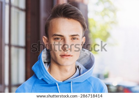 Young man portrait outdoors