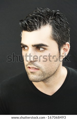 Young man portrait over black background