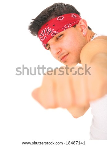 young man posing as rocker/punk stretching out his fist. isolated on white background - stock photo