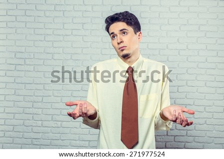 "Young man posing ""don't know"" - stock photo"