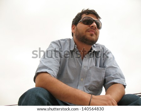 Young man posing for photographer - stock photo