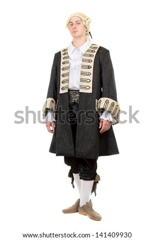 Young man posing in medieval costume and wig. Isolated on white