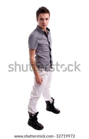 Young man posing, isolated over white background - stock photo
