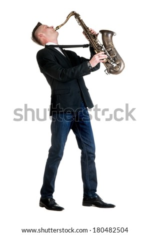 Young man posing on a white background with saxophone isolated