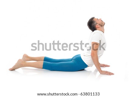 young man practising yoga postures combination cobra. isolated on white background - stock photo