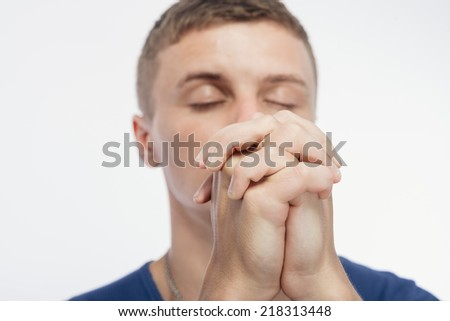young man praying - stock photo