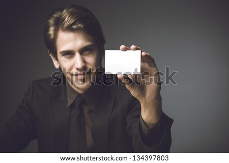 Young man presenting a business card