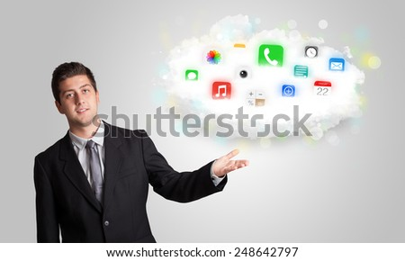 Young man presenting cloud with colorful app icons and symbols concept