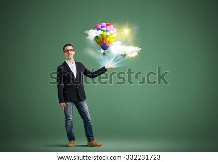 Young man presenting in hand media balloon icons on color background