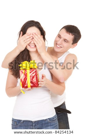 Young man presents gift to woman, on white background