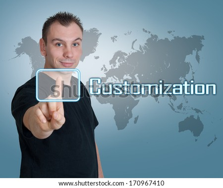 Young man press digital Customization button on interface in front of him - stock photo