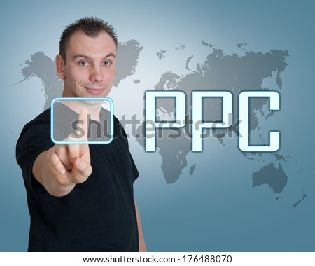 Young man press digital Pay per Click button on interface in front of him - stock photo