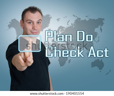 Young man press digital Plan Do Check Act button on interface in front of him - stock photo