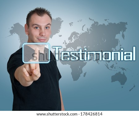 Young man press digital Testimonial button on interface in front of him - stock photo