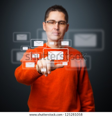 Young man pressing messaging type of digital interface - stock photo